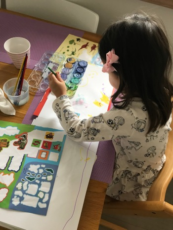 Toddler play time stickers and painting