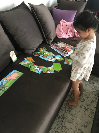 Toddler playing with puzzles
